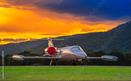 Airplane model of Bombardier Learjet 35A parking on the apron with beautiful sunset and mountain Background Fototapet