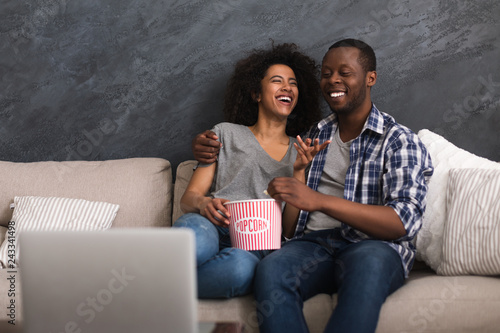 Fotografie, Tablou Afro-american couple watching video on laptop.