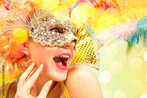 Tuinposter Carnaval Beautiful surprised woman in carnival mask. Beauty model woman wearing masquerade mask at party over holiday background with magic glow. Christmas and New Year celebration. Glamour lady with perfect