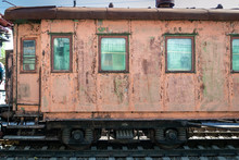 Old Rusty Passenger Railway Wagon With Peeling Paint