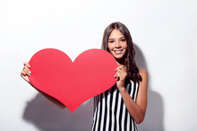 Young Girl Holding Red Paper Heart On White Background