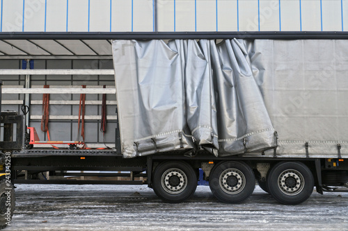 Fotografie, Obraz  A semi-trailer with an exposed tarpaulin during unloading