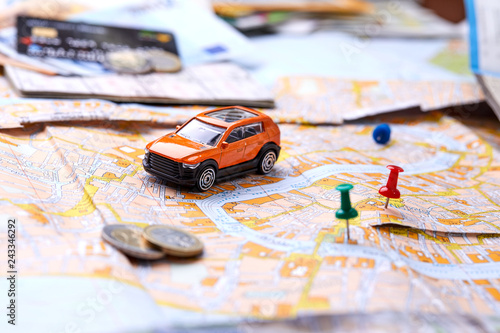 Fotografia  travel concept - small toy car on the map