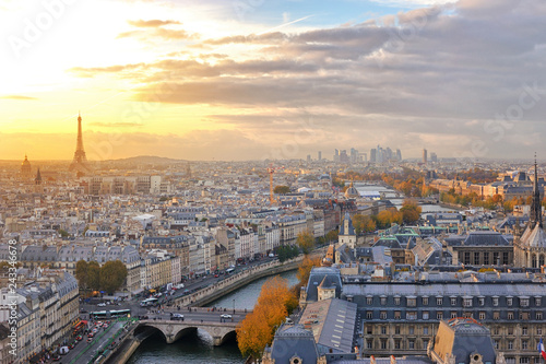 Fotomagnes View of Paris skyline with colorful sunset light seen from the top of Notre Dame cathedral.