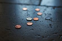 Coins On Tile Ground