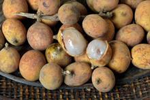Brazilian Fruit: Stack Of Pitomba In The Wicker Basket