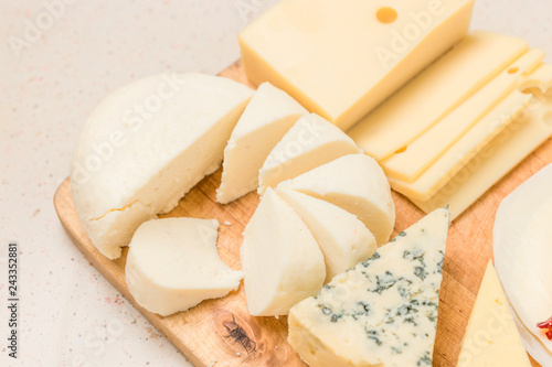 Fotografía  Different kinds of cheeses, with dried meat