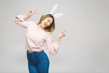 Effortless Beauty. Portrait Of Beautiful Happy Young Woman In Bunny Ears Smiling While Standing Against White Background.