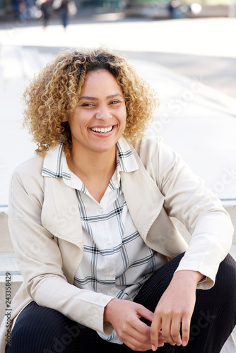 Close up beautiful african american woman smiling in city Wall mural