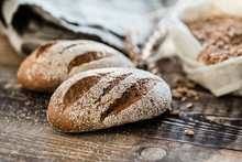 Fresh Bread With Flour On The Wooden Background
