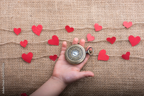 Fotografie, Obraz  Love concept with pocket watch and  heart shaped icons