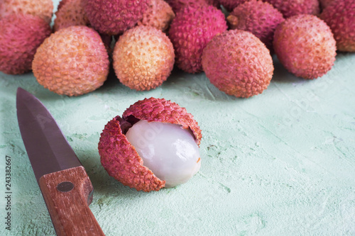 Delicious lychees on a green table. Top view.