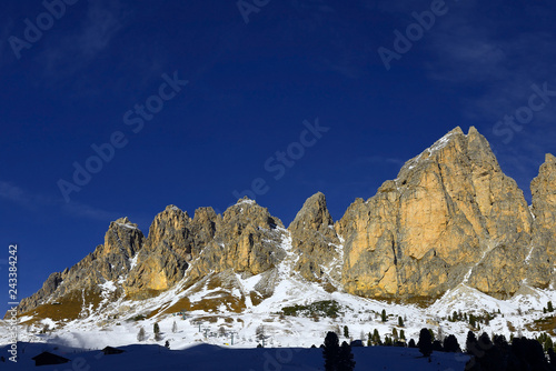 Fotografie, Obraz  Rock wall of the mountain massif Puez from the Gardena Pass, Alta Badia, Dolomites, South Tyrol, Italy - The Dolomites are UNESCO World Heritage Site