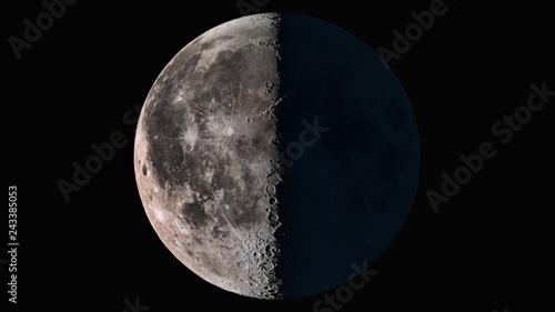 Fototapeta The beauty of the universe: Wonderful super detailed third quarter Moon obraz