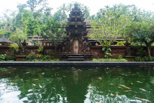 Lake By Old Temple Amidst Tree...