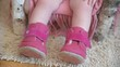 Baby runs shoes. Feet baby in pink shoes. cozy winter. Zinyaya shoes on baby. pink boots with velcro.
