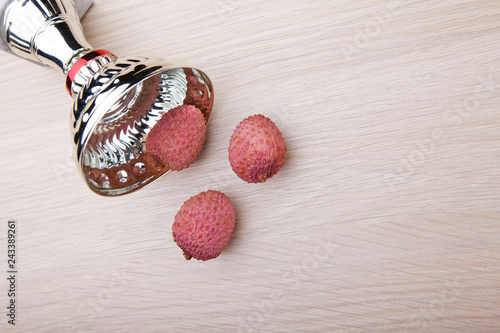 lychee fruit silver cup nobody wooden background