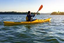 Girl On A Kayak On The River