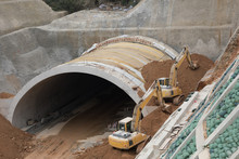 Highway Tunnel Construction Site With Yellow Tractors