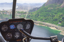 View From A Helicopter Cockpit Flying Over Rio De Janeiro, Brazil. Cockpit With Instruments Panel. Captain In The Aircraft Cockpit. Selective Focus, Horizontal