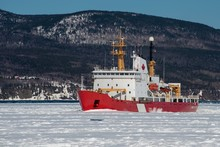 Canadian Coast Guard Icebreaker At Work In The Bay Of  Gaspe, Quebec, Canada.