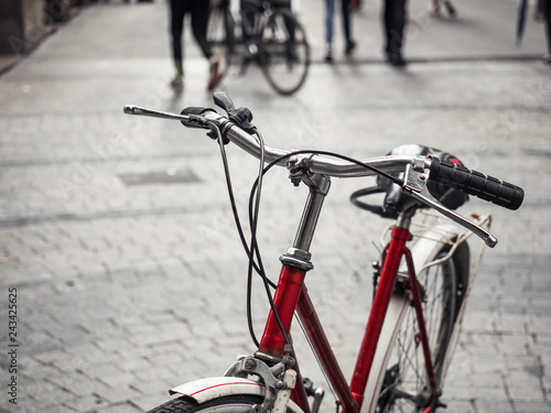 Fotografie, Obraz  Bicycle on street with People walking city Travel ecology lifestyle friendly cit