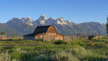 A Sunrise Wide Shot Of A Mormon Row Barn And Grand Teton Mountain In Grand Teton National Park In The United States Of America