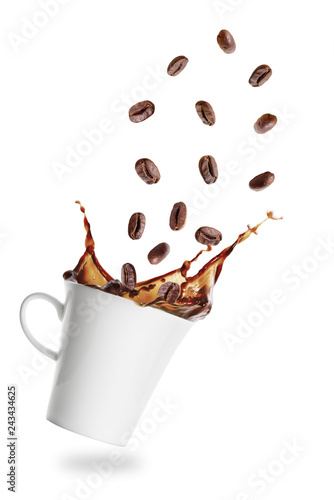 Coffee grains flying into cup of espresso with splash
