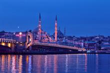 Galata Bridge And Yeni Cami Mosque In Istanbul At Night