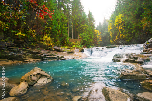 Obraz Waterfall on mountain river in the forest - fototapety do salonu