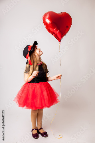 Photo  Sweet child girl with red heart