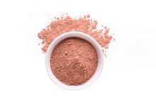 Dry Red Clay Powder Mask For Face And Body  In Ceramic Bowl Isolated On White
