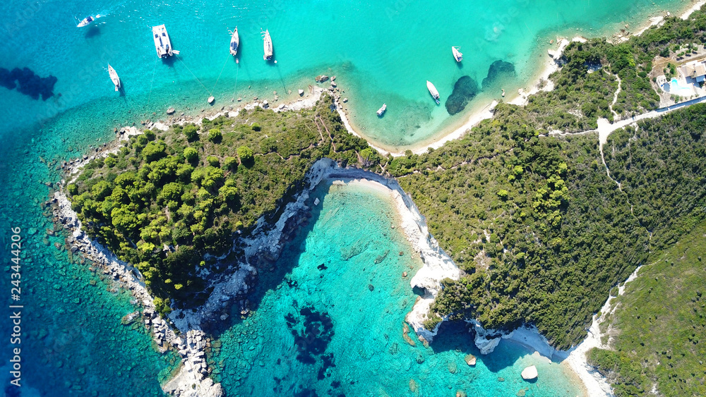 Fototapety, obrazy: Aerial drone bird's eye view photo of sail boats docked in tropical caribbean paradise bay with white rock caves and turquoise clear sea