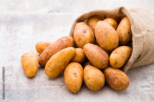 A bio russet potato wooden vintage background.