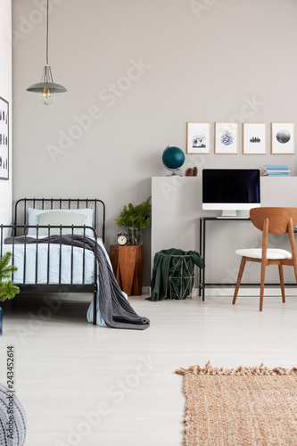 Elegant Grey Teenager Bedroom With Single Metal Bed With Blue Bedding And Grey Blanket Real Photo With Copy Space On The Empty Wall Stock Photo Adobe Stock