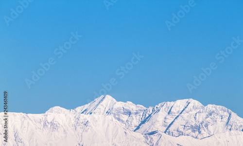 Front View Of Mountains With Snow And Blue Sky, Background Picture