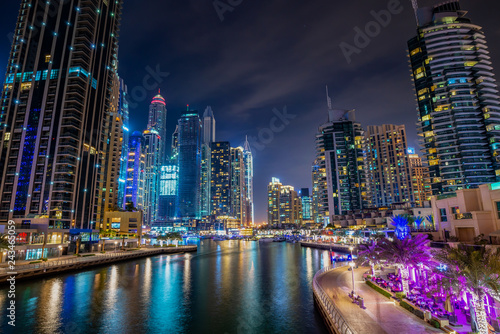 Dubai marina walk at night with illuminated buildings, United Arab Emirates