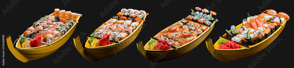 Fototapety, obrazy: Sushi set in a wooden boat on a black background