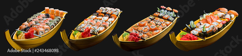 Fotografía  Sushi set in a wooden boat on a black background
