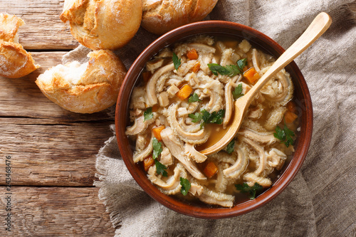 Polish stew flaki with vegetables close-up in a bowl. Horizontal top view