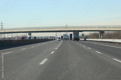 Foto op Plexiglas Motorsport lanes with cars and trucks on italian highway