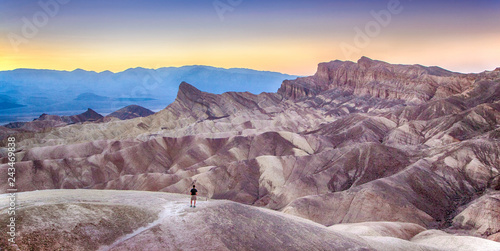 Spoed Foto op Canvas Centraal-Amerika Landen Man watching sunset at Zabriskie Point, Death Valley National Park, California, USA