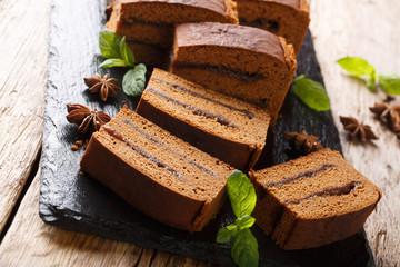 Delicious Polish dessert cake piernik in plum jam close-up. horizontal