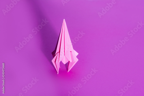 Fototapeta  rocket from paper of origami on a pink background
