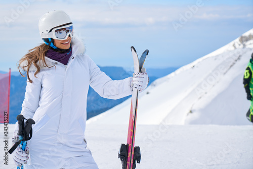 Canvas Prints Winter sports Portrait of beautiful woman with ski and ski suit in winter mountain.
