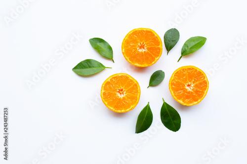 Fotografie, Obraz  Orange fruits with  leaves on white background.