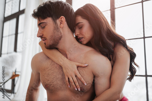 Valokuva Satisifed and passionate couple sitting on bed in room together