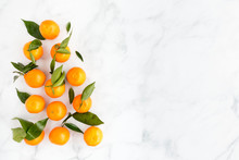 Arrangement Of Clementines On White Marble Background