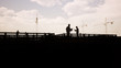 Engineers, construction workers and cranes in silhouette 3d rendering