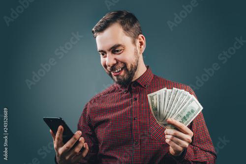 Fototapeta Man celebrating victory after making bets at bookmaker website obraz na płótnie